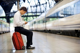 Businessman on Train Platform Text Messaging